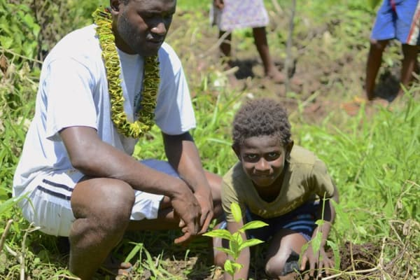 Loru Forest Vanuatu Plan Vivo father and son planting trees